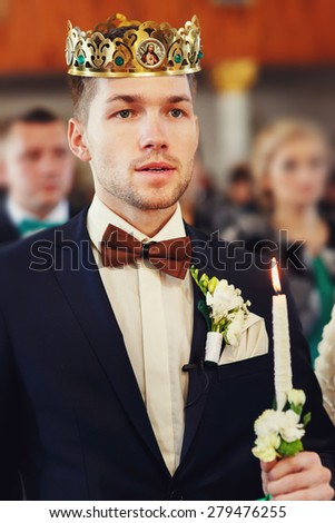 groom during orthodox wedding ceremony with crown - stock photo