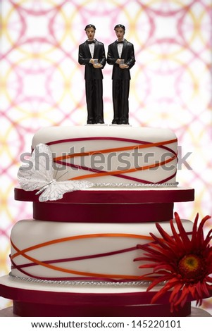 Groom Figurines on Wedding Cake - stock photo
