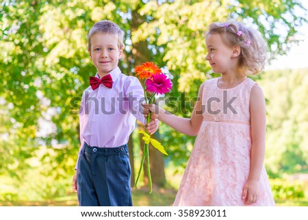 Groom gives a little girl a bouquet of flowers - stock photo