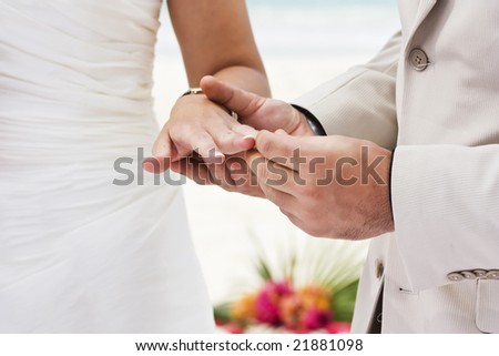Groom giving an engagement ring to his bride - stock photo