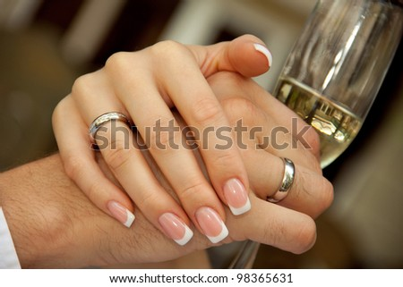 groom holding a glass. bride groom holding hands - stock photo