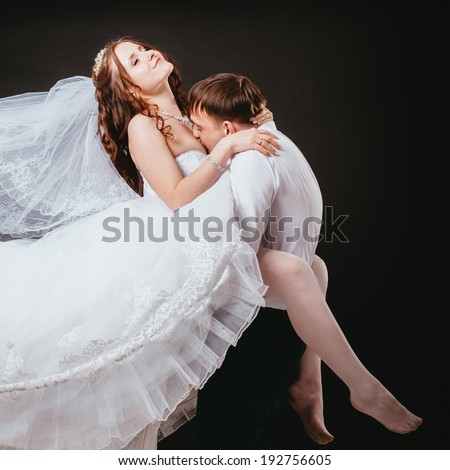 Man kissing girl breast