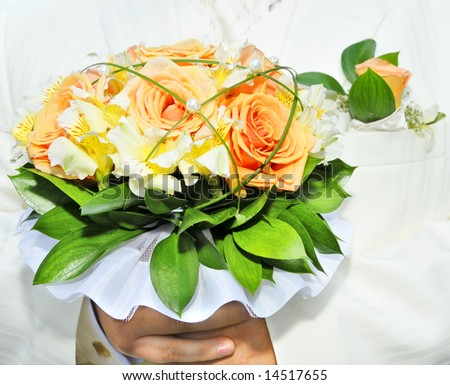 groom in luxurious wedding suit with wedding bouquet