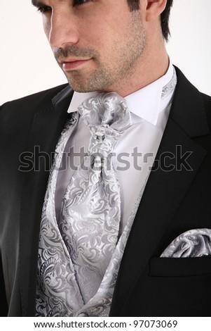 Groom in pose in white background - stock photo