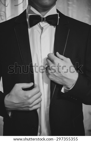 groom is preparing for a wedding celebration - stock photo