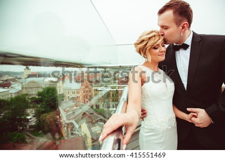 groom kissing beautiful young wife - stock photo