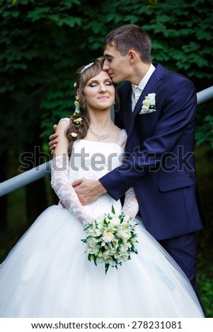 Groom kissing bride - stock photo