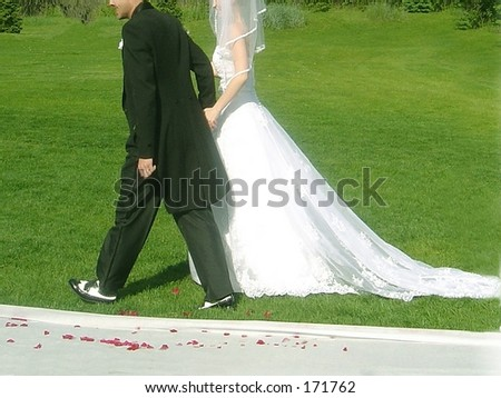 groom leading bride to reception - stock photo