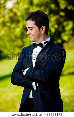 groom portrait on a park at a wedding day - stock photo