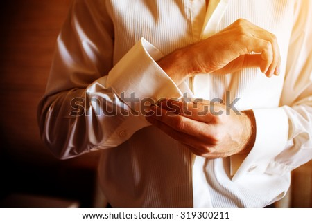 Groom preparing for the morning of the wedding ceremony - stock photo