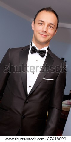 Groom preparing himself for wedding - stock photo