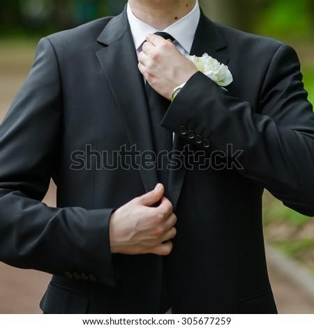 Groom preparing his suit, tie wedding, the final preparations before the wedding ceremony - stock photo