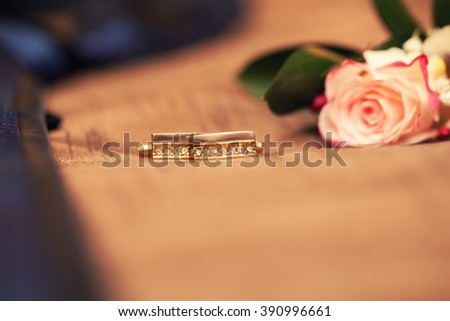 groom's accessories. Gold cuff links, a tie and a buttonhole from a rose. cuff links close up - stock photo
