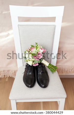 Groom's morning. Wedding accessories. Shoes and wedding bouquet - stock photo
