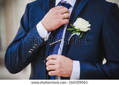 Groom set the bowtie straight - stock photo