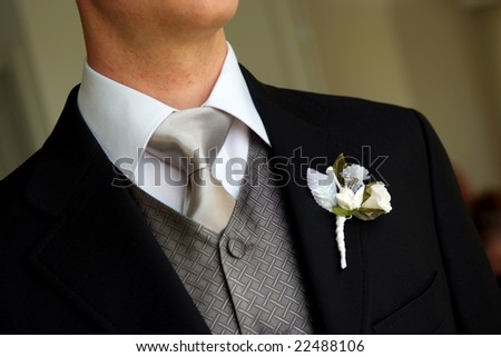 Groom wearing boutonniere - stock photo