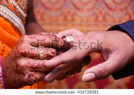 stock-photo-groom-wearing-wedding-ring-w