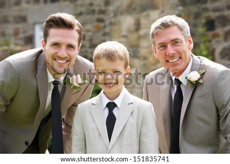 Groom With Best Man And Page Boy At Wedding - stock photo