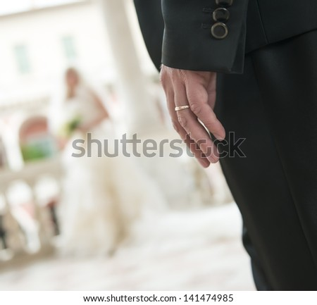 groom with ring  wait for his bride in palace balcony in Italy - stock photo