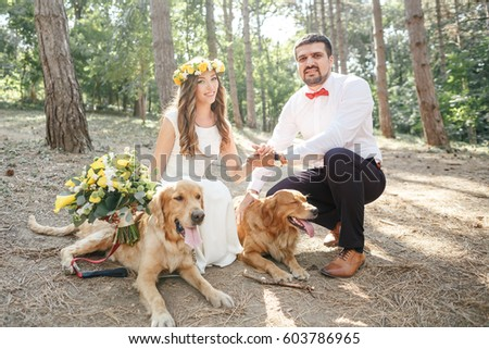 groom with the bride and the dog