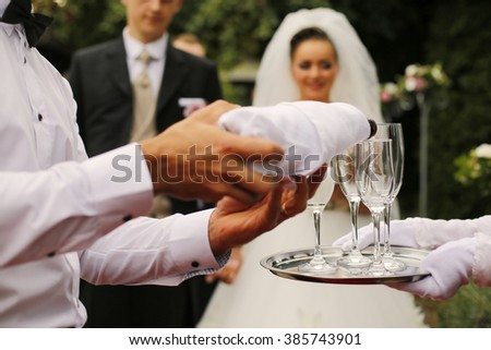 Grooms toasting with champagne  - stock photo