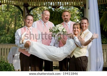 Groomsman Holding the Bride - stock photo