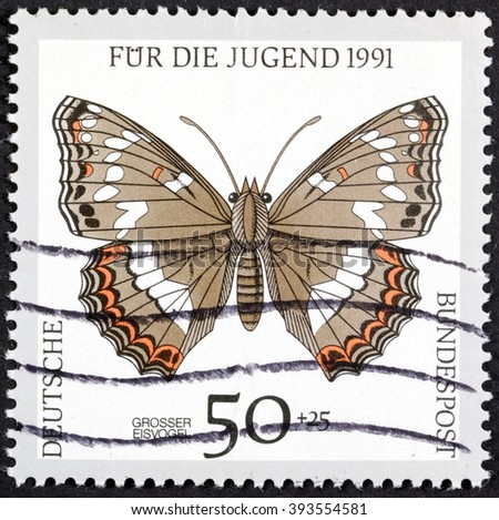 GROOTEBROEK ,THE NETHERLANDS - MARCH 15,2016 :A stamp printed in Germany showing  butterfly, circa 1991  - stock photo
