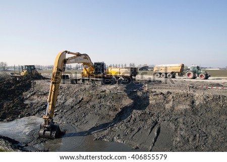 GROOTEBROEK, THE NETHERLANDS - MARCH 17, 2016: Hydraulic crane is engaged in excavation work for the construction of a new motorwayon march 17, 2016  in Grootebroek , the netherlands. - stock photo