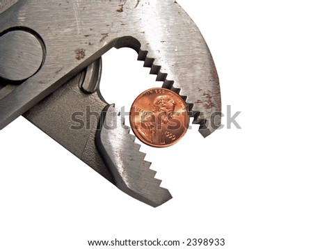 Groove lock pliers griping or squeezing a United States penny - stock photo