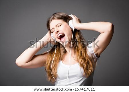 Groovy Girl Listening to Music - stock photo