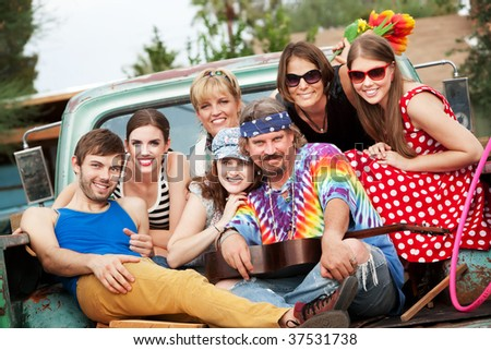 Groovy Group in the Back of Truck Smiling - stock photo