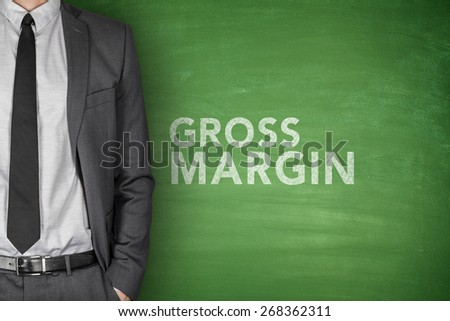 Gross margin text on green blackboard with businessman - stock photo