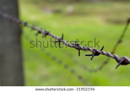 Gross-Rosen Nazi concentration camp - barbed wire fence closeup