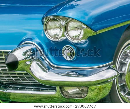 GROSSE POINTE SHORES, MI/USA - JUNE 21, 2015: A 1958 Cadillac Eldorado headlight at the EyesOn Design car show, held at the Edsel and Eleanor Ford House. - stock photo