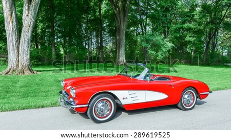 GROSSE POINTE SHORES, MI/USA - JUNE 17, 2015: A 1959 Chevy Corvette car at the EyesOn Design car show, held at the Edsel and Eleanor Ford House. - stock photo