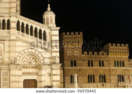 Grosseto (Tuscany, Italy), cathedral facade and historic palace by night - stock photo