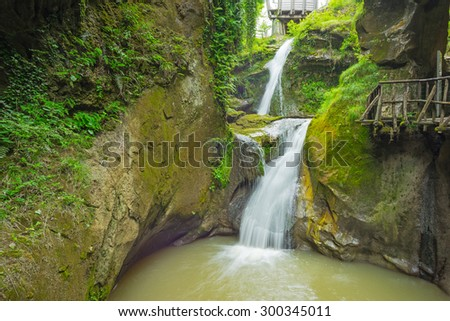 Grotto del Cagleron and waterfall in Italy
