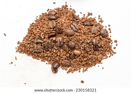 Ground and instant coffee over white background - stock photo