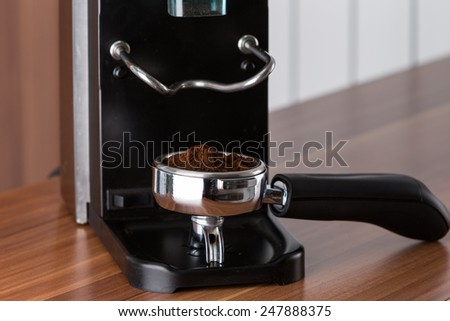ground arabica seeds for espresso - stock photo