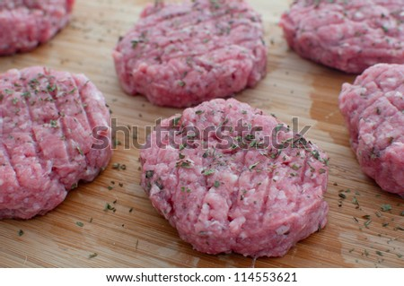 Ground beef patties uncooked closeup horizontal - stock photo