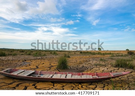 Ground broken by the drought ship aground. - stock photo