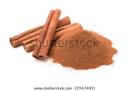 Ground cinnamon and cinnamon sticks isolated on white - stock photo