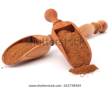 ground cinnamon spice powder in wooden spoon isolated on white background cutout - stock photo