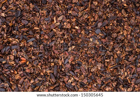 Ground Covered with Wet Compost Mulch - stock photo