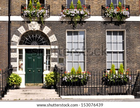 Ground floor facade of preserved 18th century Georgian London terraced house. - stock photo