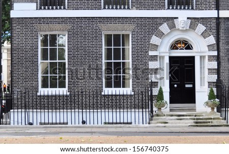 Ground floor facade of 18th century Georgian London house. - stock photo