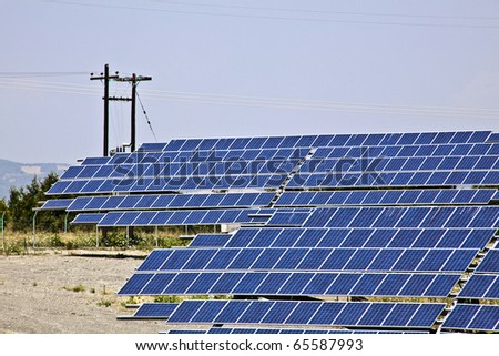 Ground installation of photovoltaic modules, solar panels. - stock photo