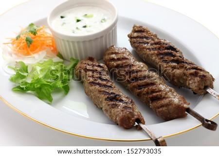 ground lamb kebab on white background  - stock photo