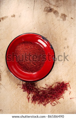 ground moroccan and whole treads saffron in pile, super  shallow dof - stock photo