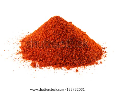 Ground of red chili hot pepper. Hill of sweet paprika on white background. Isolated healthy spicy.